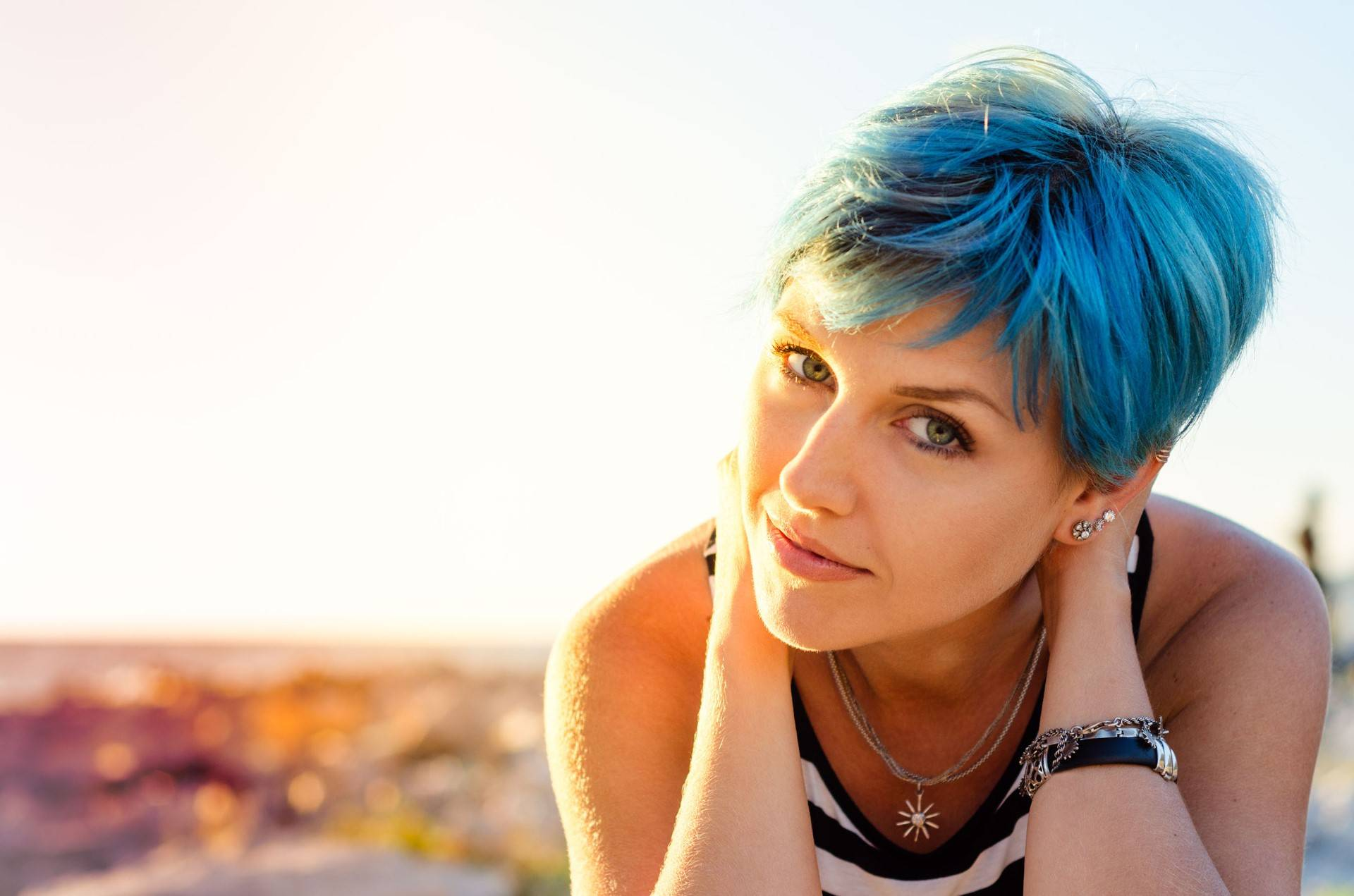 A portrait of beautiful girl with blue hair in sailor's striped top.